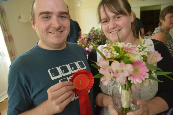 Nicola Burton (pictured with her husband Dave) with her award winning bouquet (Picture by Lewis Clarke)