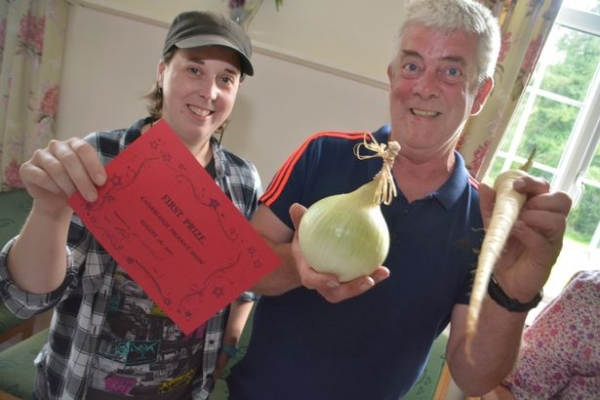 Hazel and her father Quentin Dickinson with a prize winning onion (Image: Lewis Clarke)